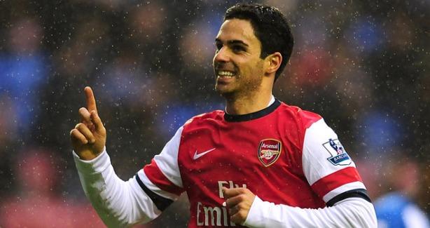 Arteta celebrates his goal against Wigan.