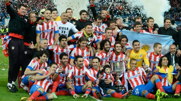 Atleti players bask in Copa Del Rey glory.
