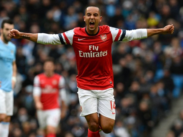 Walcott celebrates his goal against Manchester City